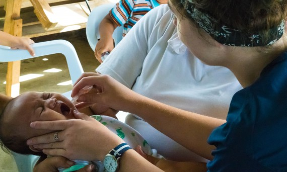 Erin administers a polio vaccine