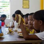 children enjoying their food
