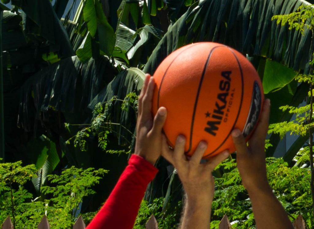 3 hands on a basketball