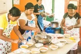 4 women making cakes