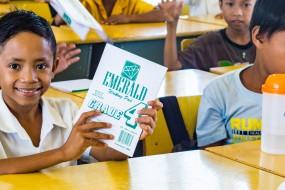 a boy holding a new school book