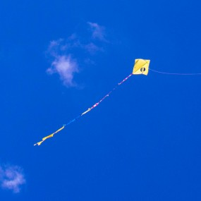 flying kite with clouds