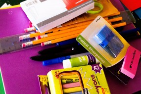 crayons,pencils,note pad and scissors