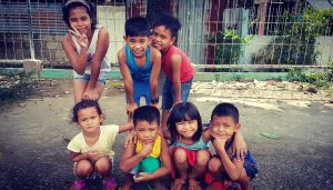 children smiling in the philippines